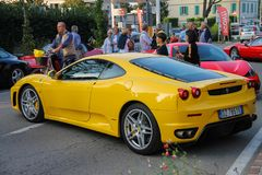 People on car exhibition from Ferrari Museum on streets of Spila. Spilamberto, Italy- October 02, 2016: People on car exhibition from Ferrari Museum on streets Royalty Free Stock Photo