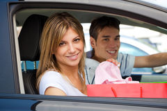 People in car after shopping royalty free stock photography