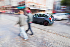People and car traffic in the city Royalty Free Stock Photos