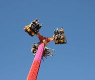 People on carnival ride in sky. People hanging upside down enjoying a carnival ride. Taken in Arizona 2016 Stock Image