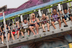 People on carnival ride at state fair. DES MOINES, IA /USA - AUGUST 10: Unidentified people enjoy a carnival thrill ride at the Iowa State Fair on August 10 Stock Photos