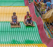 People on carnival slide at state fair Royalty Free Stock Images