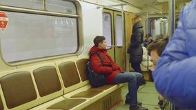 MOSCOW - CIRCA APRIL, 2018: People in carriage of train in subway. People in carriage of train in subway in Moscow stock footage