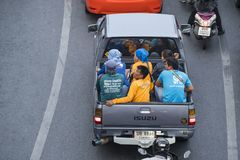 People carried in Bangkok. People carried on a pickup on the road in Bangkok, Thailand Stock Images