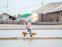 People carry baskets of salt Royalty Free Stock Images