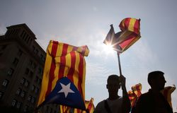 Demonstration for freedom and against political prisoners in barcelona. People carry a giant estelada flag, pro separatist catalan flag, and banners during a Stock Images