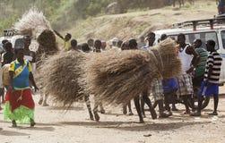 People carry twigs at village market. Bonata. Omo Valley. Ethiop Stock Photo