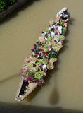 People carrying flowers on the river in Ben Tre, Vietnam Stock Image