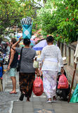 People carrying goods to the market in Bali, Indonesia Stock Photo