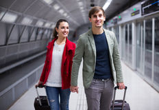 People carrying luggage at metro Royalty Free Stock Photo