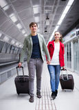 People carrying luggage at metro Royalty Free Stock Images