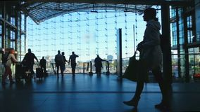 People carrying suitcases at busy railway station, going up and down escalators. Stock footage stock footage