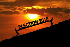 People carrying text of election 2016 Royalty Free Stock Photography