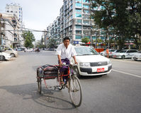 People, cars and bikes on the streets in Mandalay Royalty Free Stock Photography