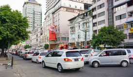 People, cars and bikes on the streets in Mandalay Royalty Free Stock Photo