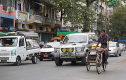 People, cars and bikes on the streets in Mandalay Stock Images