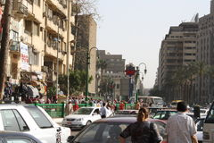 People, cars, buildings in downtown tahrir, Cairo Egypt Stock Photos
