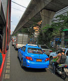 People in cars, buses and on motorbikes are moving, Bangkok, Thailand Royalty Free Stock Photos
