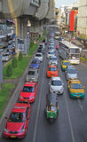 People in cars, buses and on motorbikes are moving, Bangkok, Thailand Royalty Free Stock Photography