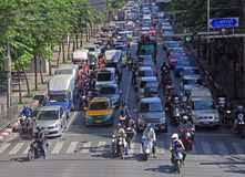 People in cars, buses and on motorbikes are moving, Bangkok, Thailand Stock Photos