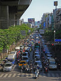 People in cars, buses and on motorbikes are moving, Bangkok, Thailand Stock Images