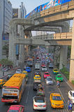 People in cars, buses and on motorbikes are moving outdoor, Bangkok, Thailand Royalty Free Stock Photography