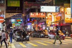 People and cars in Kowloon, Hong Kong at dark Stock Photography