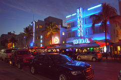 People and cars move alongside the night Ocean Drive street Royalty Free Stock Photo
