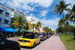 People and cars move down the Ocean Drive Stock Image