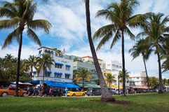 People and cars move down the Ocean Drive Stock Images