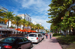People and cars move down the Ocean Drive Royalty Free Stock Image
