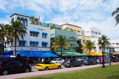 People and cars move down the Ocean Drive Royalty Free Stock Photography