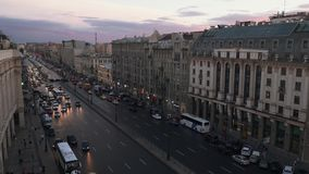 People and cars moving along prospect in Saint Petersburg at evening stock video footage