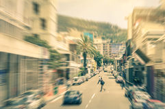 People and cars moving around on Longstreet in Cape Town royalty free stock photo