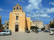 People and cars near the church  of the Piazza Matrice in Favign Royalty Free Stock Photography