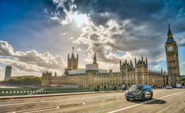 People and cars over Westminster Bridge, London - UK Stock Photos