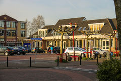 People and cars on the parking in Meerkerk, the Netherlands Stock Image