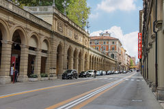 People and cars on the street Indipendenza in Bologna, Italy. Bologna, Italy - August 18, 2014: People and cars on the street Indipendenza in Bologna, Italy Stock Image