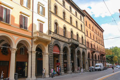 People and cars on the street Indipendenza in Bologna, Italy. Bologna, Italy - August 18, 2014: People and cars on the street Indipendenza in Bologna, Italy Royalty Free Stock Photo