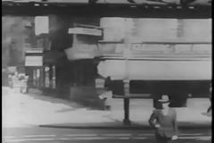 People and cars under elevated subway in New York City, 1930s stock video