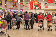 People with carts in a supermarket Stock Images