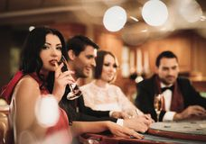 People in a casino. Group of young people playing poker in a casino Royalty Free Stock Photos
