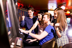 People in casino. Young people play jackpot in the casino royalty free stock photos