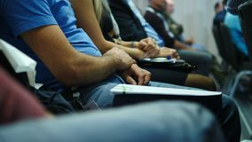 People in casual clothes at business conference or presentation, workshop. audience at seminar, business people