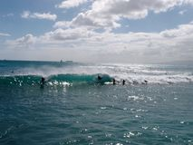 People Catch Wave as it barrels Riding Boogie boards stock photography
