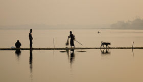 People catching fish on lake in Mandalay, Myanmar Royalty Free Stock Photos
