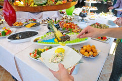People catering buffet food outdoor Royalty Free Stock Images