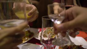 People celebrate holiday in Chinese restaurant. Eat traditional Chinese food. Close up. Let`s drink. Party stock footage