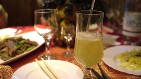 People celebrate holiday in Chinese restaurant. Eat traditional Chinese food. Close up. Pours juice into a glass. Party stock video footage