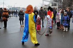 People celebrate Shrovetide in Moscow, they jump the rope Royalty Free Stock Image